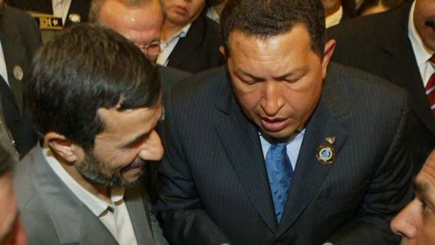 RIYADH, SAUDI ARABIA- NOVEMBER 18: Venezuelan President Hugo Chaves (R) talks to Iranian President Mahmoud Ahmadinejad (L) at the closing of the Third OPEC Summit , November 18, 2007 in Riyadh, Saudi Arabia. Iranian President Mahmoud Ahmadinejad has announced plans for  discussions with Arab nations about plans to enrich uranium in a neutral country outside of the the Middle-Eastern region, such as Switzerland (Photo by Salah Malkawi/ Getty Images)