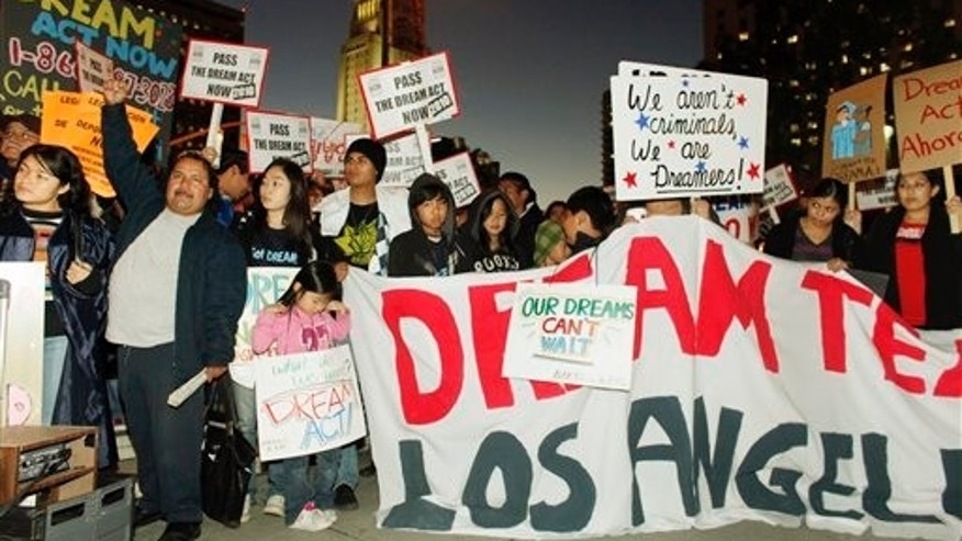 In this photo taken on Dec. 7, 2010, immigrants parents, students and others participate in a candle-light procession and vigil in support of the Federal Dream Act in downtown Los Angeles. The illegal immigrants who more than a decade ago were just teens hoping to forge a legal path to citizenship are vowing to make the Act a campaign issue come 2012, even though they'll likely be too old to benefit if the law ever passes. (AP Photo/Damian Dovarganes)