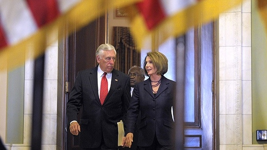Nov. 17: House Majority Leader Steny Hoyer and Speaker Nancy Pelosi walk to a news conference on Capitol Hill.