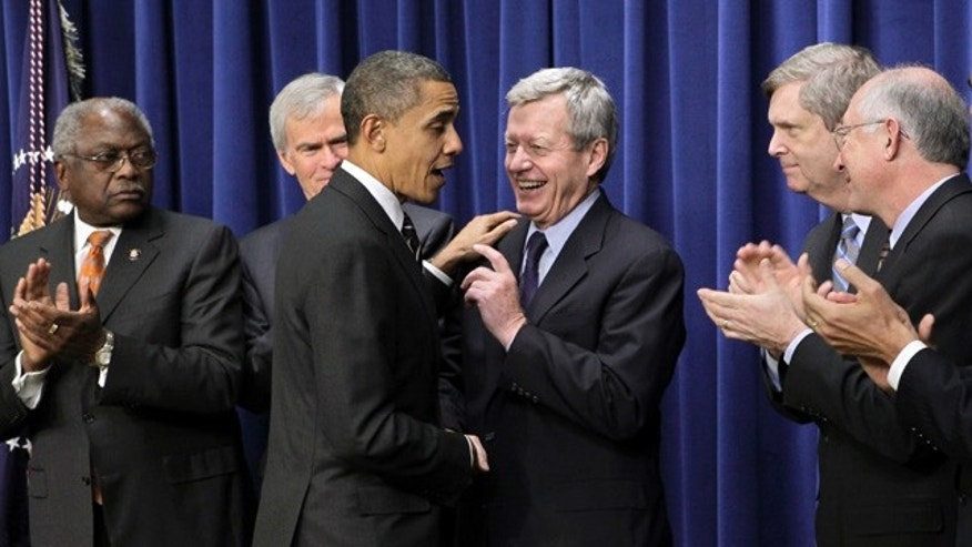 Dec. 8: Obama pauses with Sen. Max Baucus after signing the Claims Resolution Act of 2010 which settles long-standing lawsuits by African American farmers and Native Americans against the federal government, in Washington.