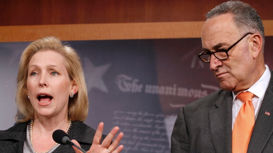 Dec. 9: Sen. Kirsten Gillibrand, D-N.Y., left, accompanied by Sen. Charles Schumer, D-N.Y., gestures during a news conference on Capitol Hill after the Senate voted down a bill to aid people who got sick after exposure to dust from the World Trade Center's collapse in the Sept. 11 attack.