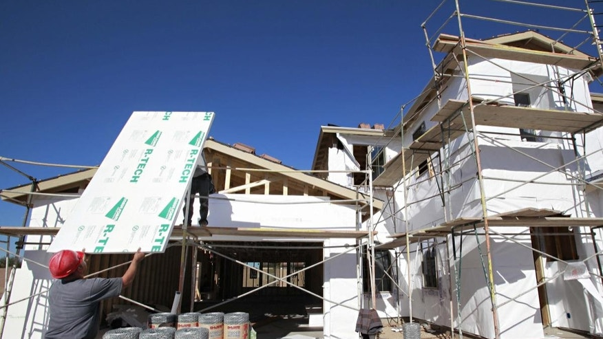 Construction workers build a house Tuesday, Nov. 30, 2010 in Gilbert, Ariz. (AP Photo/Matt York)