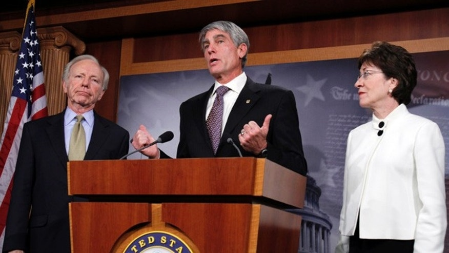 Dec. 9: Sen. Joseph Lieberman, I-Conn., Sen. Mark Udall, D-Colo., and Sen. Susan Collins, R-Maine, speak at a news conference following the defeat of a cloture motion of the Defense Authorization Bill containing repeal of the 'Don't Ask, Don't Tell' provision on Capitol Hill.