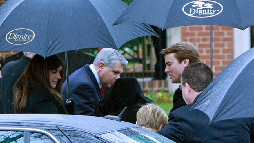 Dec. 11: Former North Carolina senator and Democratic presidential candidate John Edwards, right, and his daughter Cate, left, arrive for funeral services for Elizabeth Edwards at Edenton Street United Methodist Church in Raleigh, N.C.