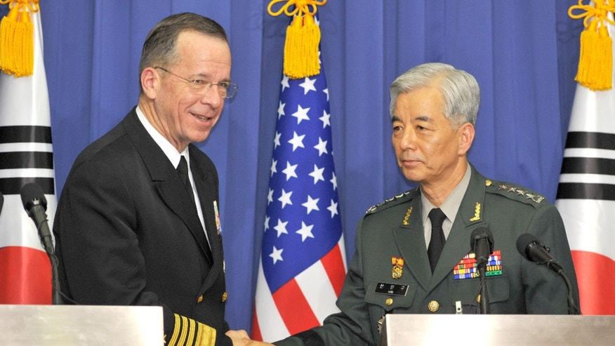 Dec. 8: Adm. Mike Mullen and South Korean Gen. Han Min-Koo shake hands after their joint press conference at the Defense ministry in Seoul. On Dec. 13 Mullen said that the danger of war or hostilities on the Korean peninsula is rising.