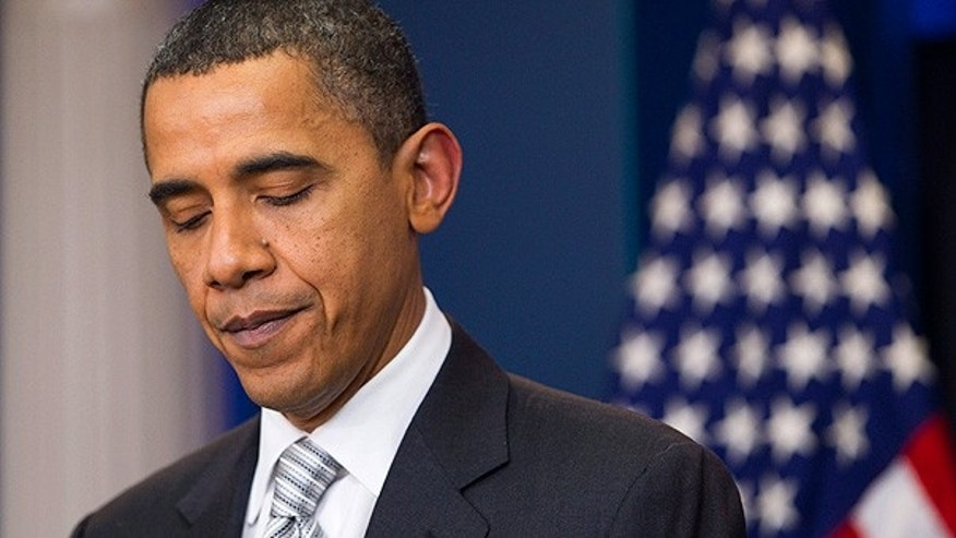 Dec. 13: President Obama pauses during a statement at the White House.