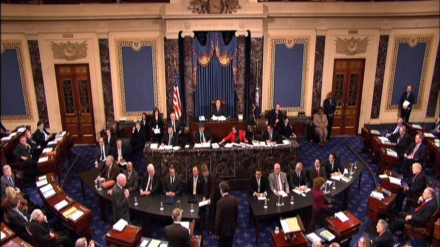 This video frame grab image provided by Senate Television shows the Senate impeachment trial of Judge G. Thomas Porteous, seated, table at right, facing camera, second from left. The attorney Porteous, facing a rare impeachment trial before the Senate argued Tuesday that Congress would be breaking with precedent by considering many of the charges against him. (AP Photo/Senate Television)