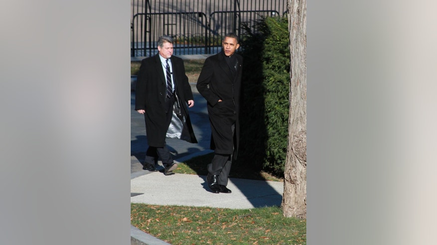 President Obama walks back to the White House after meeting with CEOs at Blair House Wednesday. (Fox News Photo)