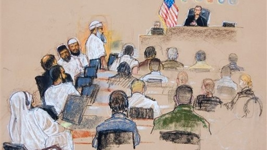 June 5, 2008: This photo shows a sketch by courtroom artist Janet Hamlin, reviewed by the U.S. Military, the Sept. 11 attacks co-conspirator suspects, at left, attend their arraignment at the war crimes courthouse at Camp Justice, the legal complex of the U.S. Military Commissions at Guantanamo Bay U.S. Naval Base in Cuba. From top left to bottom are Khalid Sheikh Mohammed, the professed mastermind of the Sept. 11 attacks, Waleed bin Attash, Ramzi Binalshibh, Ali Abd al-Aziz Ali, known as Ammar al-Baluchi, and Mustafa Ahmad al-Hawsawi. (AP)