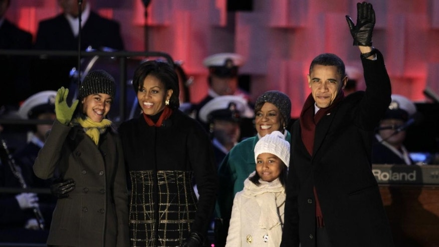 President Barack Obama, first lady Michelle Obama, daughters Malia and Sasha Obama, and mother-in-law Marian Robinson arrive for the lighting of the National Christmas Tree at the Ellipse across from the White House in Washington, Thursday, Dec. 9, 2010. (AP Photo/Charles Dharapak)
