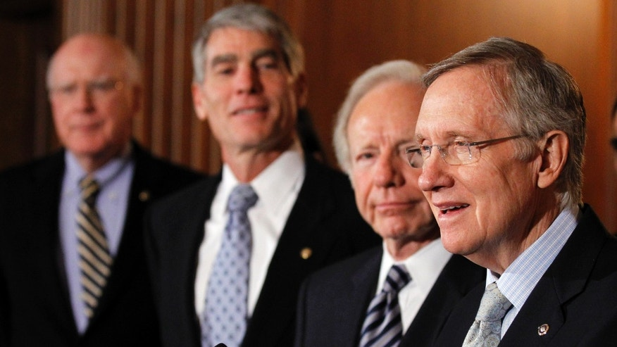 "Senate Majority Leader Sen. Harry Reid, D-Nev., from right, speaks as he stands with Sen. Joesph Lieberman, I-Conn., Sen. Mark Udall, D-Colo., and Sen. Patrick Leahy, D-Vt., at a news conference about the ""Don't Ask Don't Tell"" bill. (AP)"