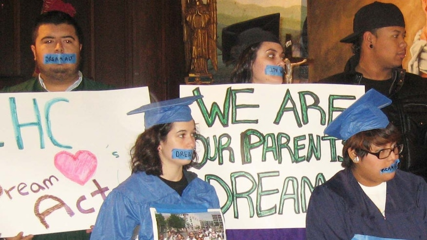 Undocumented students push for the DREAM Act at a New York rally.