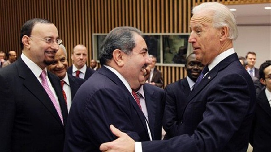Dec. 15, 2010: U.S. Vice President Joe Biden, right, greets Iraqi Foreign Minister Hoshyar Zebari, center, before a meeting of the United Nations Security Council. At left is Hamid al-Bayati, Iraq's U.N. ambassador.