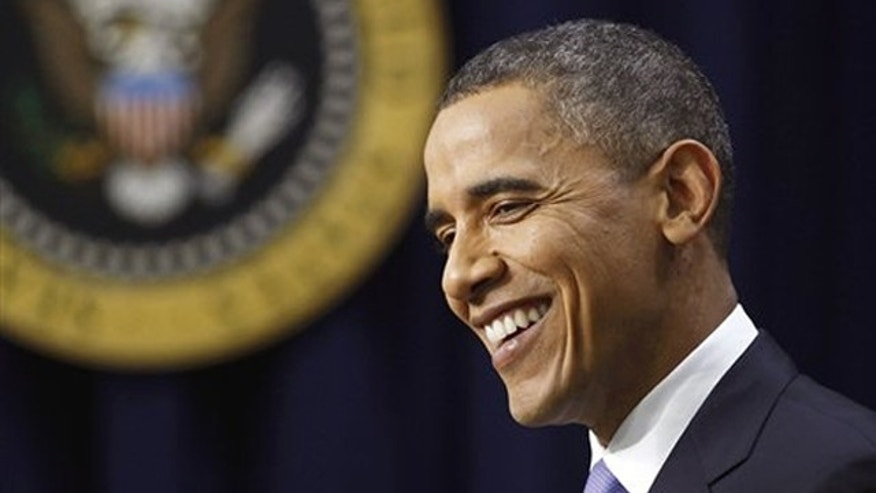 President Obama smiles during a news conference in Washington Dec. 22.