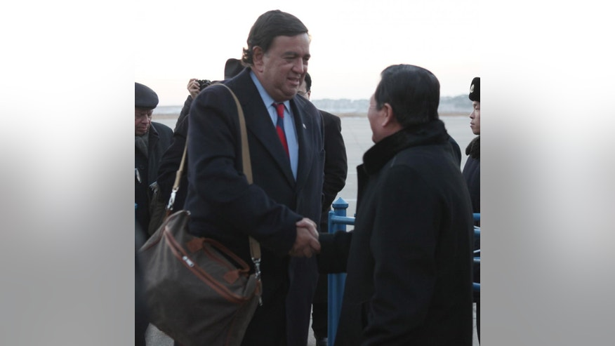 New Mexico Gov. Bill Richardson, left, is greeted by Li Gun, of the North Korean Foreign Ministry American Affairs Depertment, upon arriving at Pyongyang airport on Thursday Dec. 16, 2010. Richardson, who has frequently acted as an unofficial envoy to the North, arrived Thursday in Pyongyang after telling reporters in Beijing he expected to be given some sort of message by North Korea. (AP Photo/APTN)