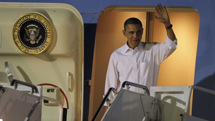President Barack Obama arrives at Hickam Air Force base in Honolulu, Hawaii, Wednesday, Dec. 22, 2010, for the his holiday vacation. (AP Photo/Chris Carlson)