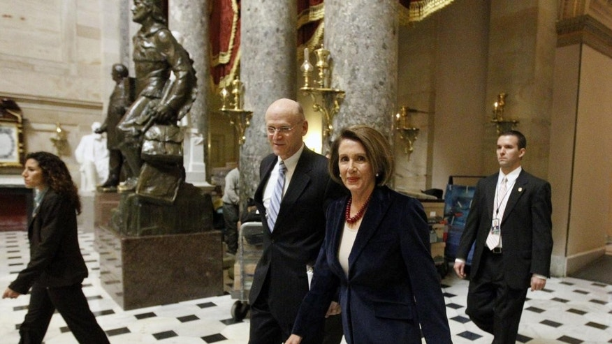 Speaker Nancy Pelosi, D-Calif., right, walks with her chief of staff John Lawrence, through Statuary Hall on Capitol Hill in Washington Tuesday, Dec. 21, 2010.(AP Photo/Alex Brandon)