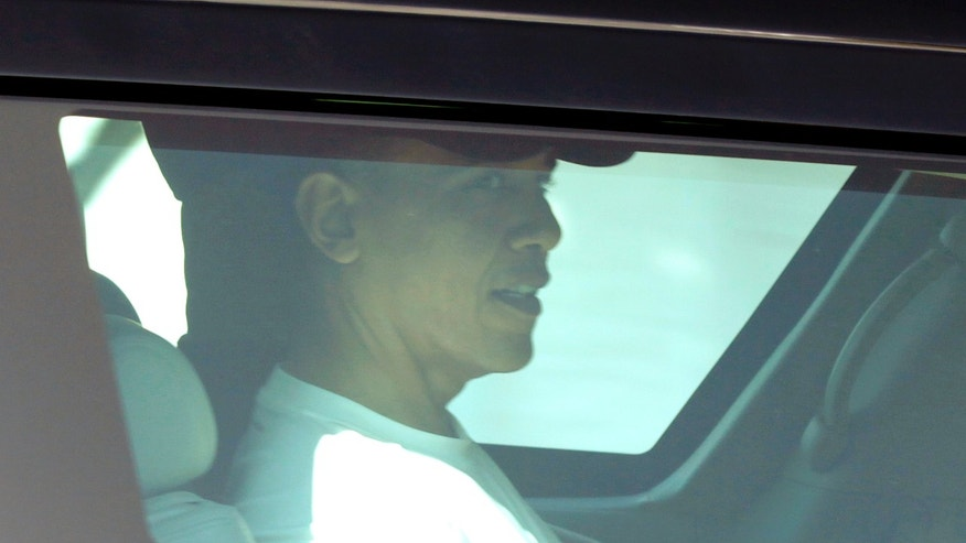 President Obama travels in a motorcade through the neighborhood where he is spending his holiday vacation in Kailua, Hawaii, Friday, Dec. 24, 2010.(AP)