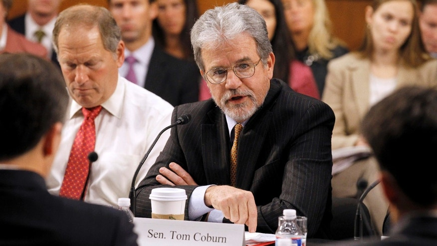 Dec. 1: Sen. Tom Coburn, R-Okla., speaks during a meeting of the commission on Capitol Hill.