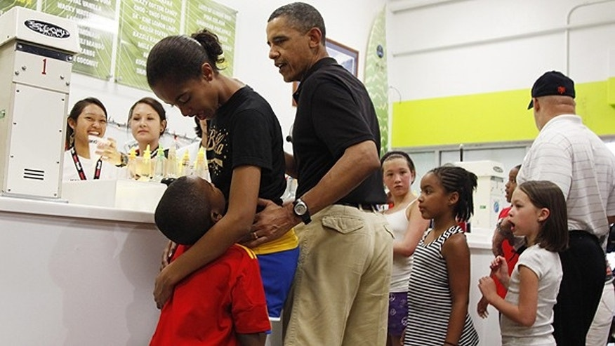 Dec. 27: President Obama, third from left, orders shave ice at Island Snow at Kailua Beach Center while on vacation with the first family in Kailua, Hawaii.