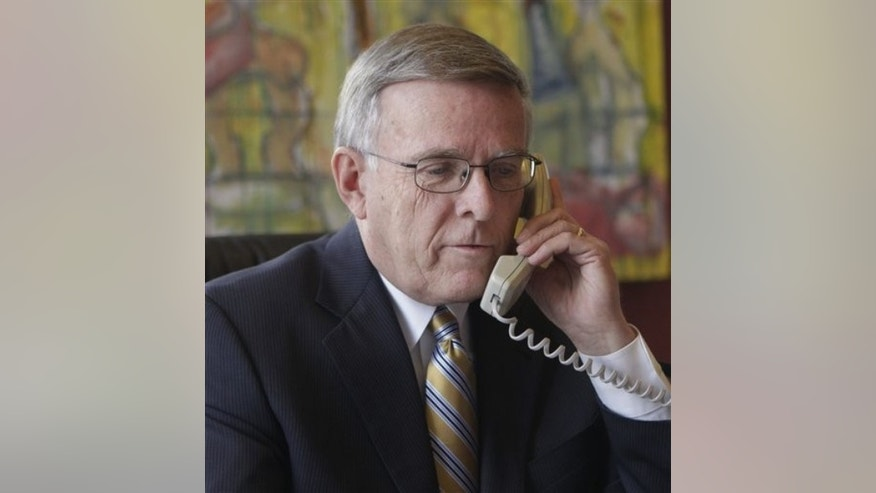 FILE: Sen. Byron Dorgan, D-N.D., talks on the phone in his office on Capitol Hill in Washington on Jan. 6, 2010.