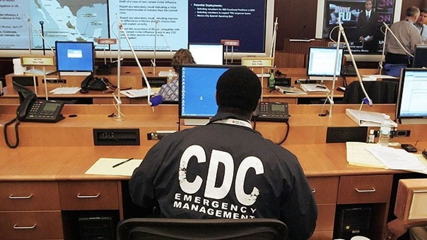 A worker at the Center for Disease Control and Prevention sits at a station in the emergency operations center as the CDC monitors swine flu development in this April 27, 2009 file photo taken in Atlanta.