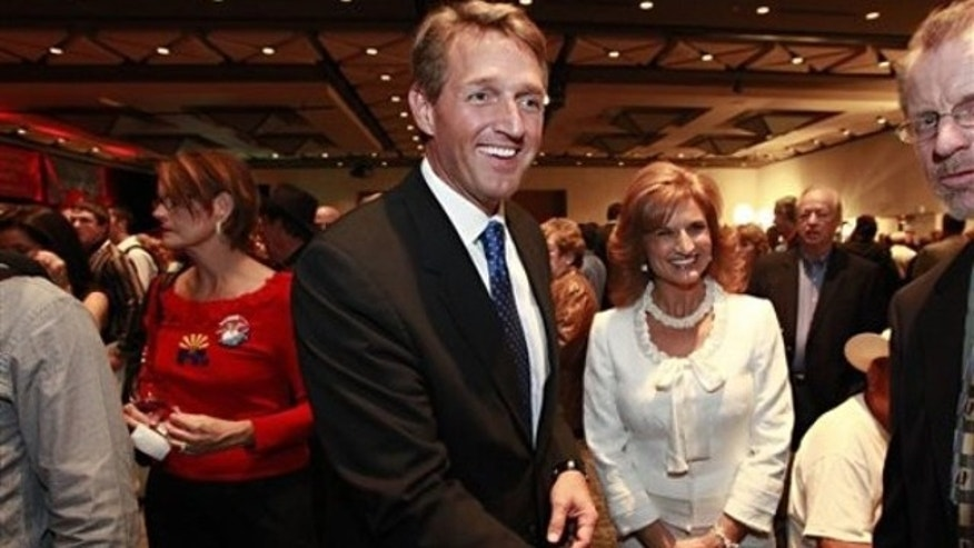 Rep. Jeff Flake, R-Ariz., and his wife, Cheryl Flake, greet supporters Nov. 2 at an election night party in Phoenix.