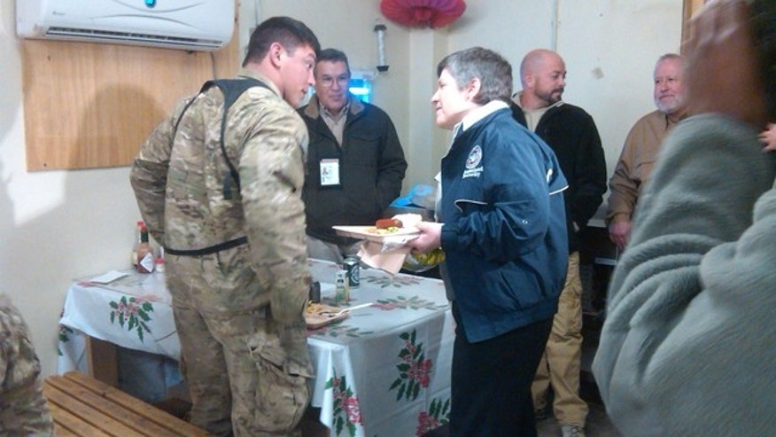 Homeland Security Secretary Janet Napolitano eats lunch Dec. 31 with troops at Torkham base near the Pakistan border.