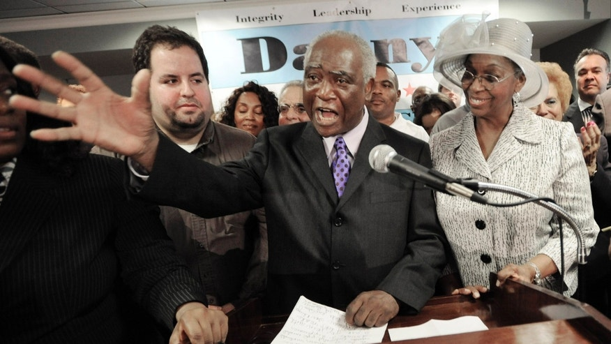 In this Nov. 14 file photo, U.S. Rep Danny Davis announces his candidacy for mayor of Chicago. On New Year's Eve, Davis announced his withdrawal from the Chicago mayoral race. (AP)