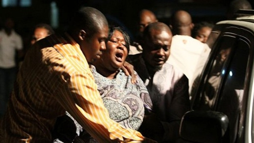 A woman who lost a relative in a bomb explosion, center, mourns at the Asokoro General Hospital, in Abuja, Nigeria, on Dec. 31.