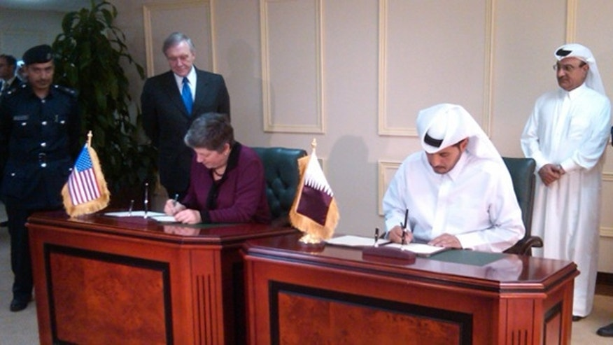 Homeland Security Secretary Janet Napolitano, left, is shown here signing a security agreement in Doha, Qatar, on Jan. 2.