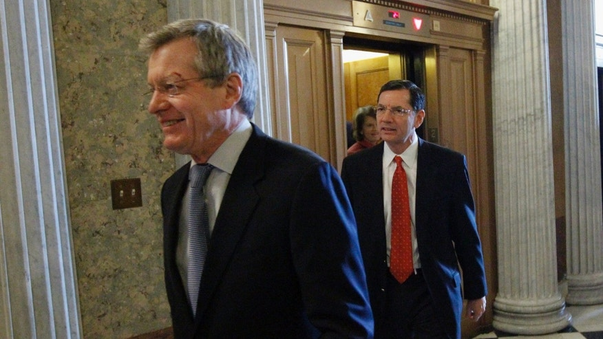 In this Dec. 18 file photo, Sen. Max Baucus, D-Mont., walks near the floor of the Senate on an unusual Saturday session on Capitol Hill. Jan. 3 Baucus said he plans to marry Melodee Hanes, his girlfriend and former director of his state offices.
