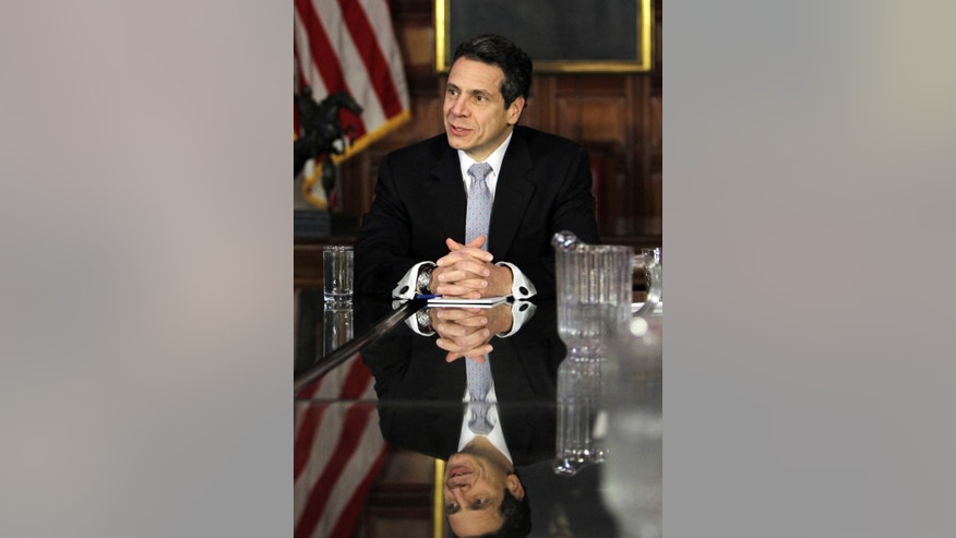 New York Gov. Andrew Cuomo speaks during a cabinet meeting in the Red Room at the Capitol in Albany, N.Y., Saturday, Jan. 1, 2011. Cuomo was sworn in Friday night in a private family ceremony at the executive mansion with his father, former Gov. Mario Cuomo, at his side. (AP Photo/Mike Groll, Pool)