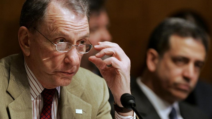 In this Tuesday, Jan. 30, 2007 file photo, then  Sen. Arlen Specter, R-Pa., ranking Republican on the Judiciary Committee, left, and Sen. Russ Feingold, D-Wis., listen to testimony on Capitol Hill in Washington. (AP File Photo/Haraz N. Ghanbari)
