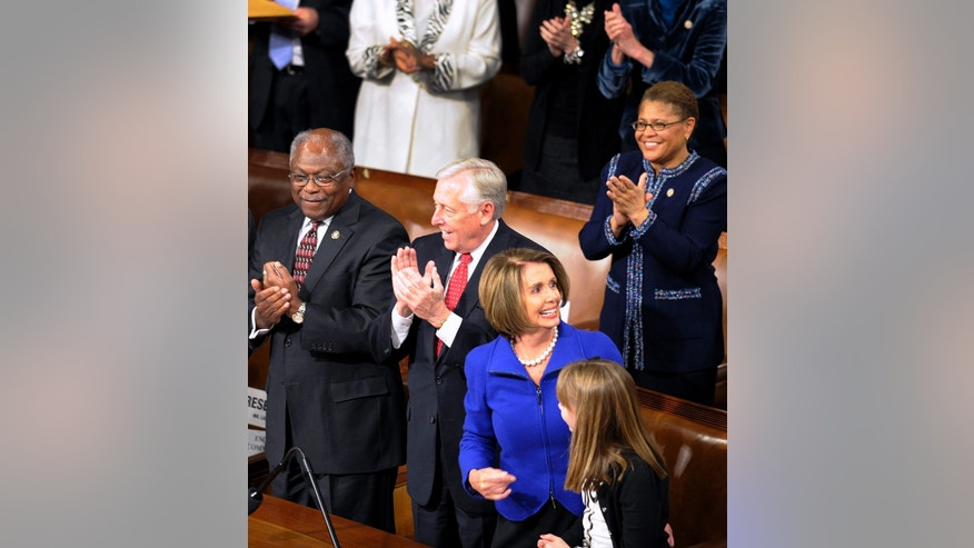 Outgoing House Speaker Nancy Pelosi of California reacts to the applause during the opening session of the 112th Congress. Assistant House Minority Leader James Clyburn of South Carolina is at left and House Minority Whip Steny Hoyer of Maryland stands in the middle.