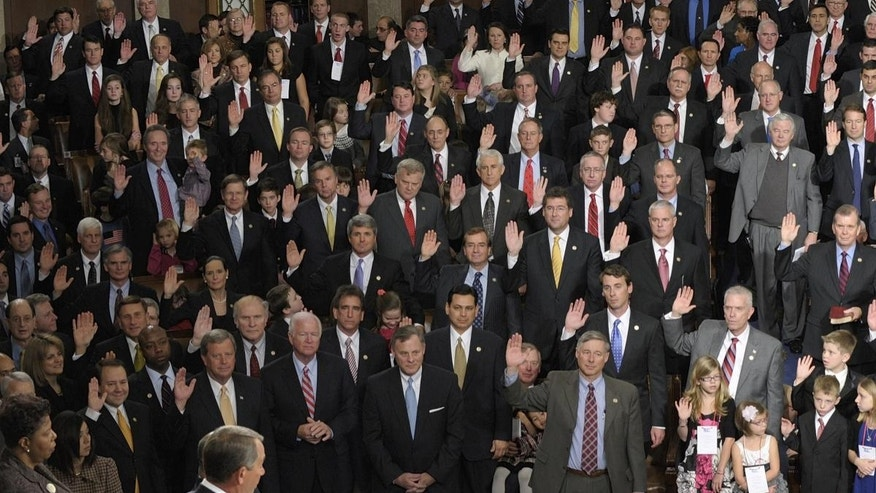 House Speaker John Boehner of Ohio delivers the oath of office to members of the House of Representatives during the first session of the 112th Congress, on Capitol Hill in Washington, Wednesday, Jan. 5, 2011. (AP Photo/Susan Walsh)