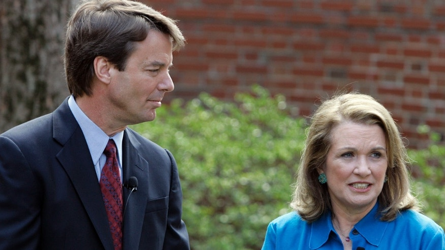 In this March 2007 file photo, Democratic Presidential hopeful John Edwards, left, listens to his then-wife Elizabeth speak about her recurrence of cancer during a news conference in Chapel Hill, N.C.  John Edwards reportedly has proposed to his mistress, barely three weeks after his wife Elizabeth's death.