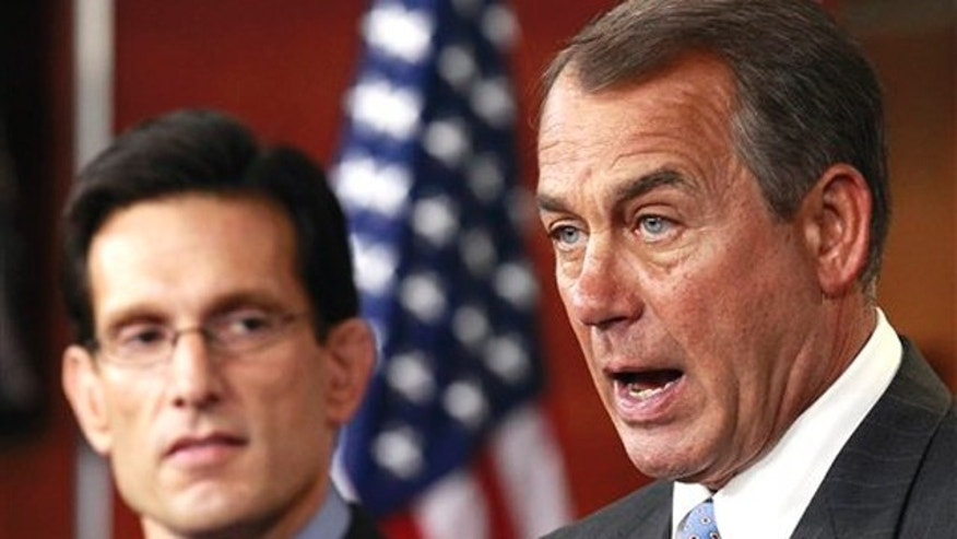 Jan. 6: House Speaker John Boehner, right, accompanied by House Majority Leader Eric Cantor, speaks to the media on Capitol Hill.