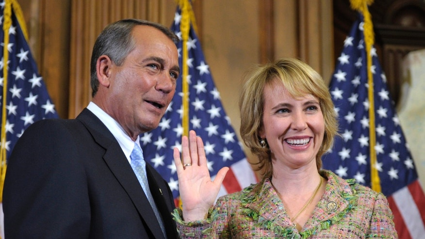 In this Jan. 5, 2011 file photo, House Speaker John Boehner reenacts the swearing in of Rep. Gabrielle Giffords, D-Ariz., on Capitol Hill in Washington. (AP)
