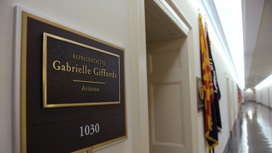 The sign for the Capitol Hill office of Rep. Gabrielle Giffords, D-Ariz., Saturday, Jan. 8, 2011 on Capitol Hill in Washington.
