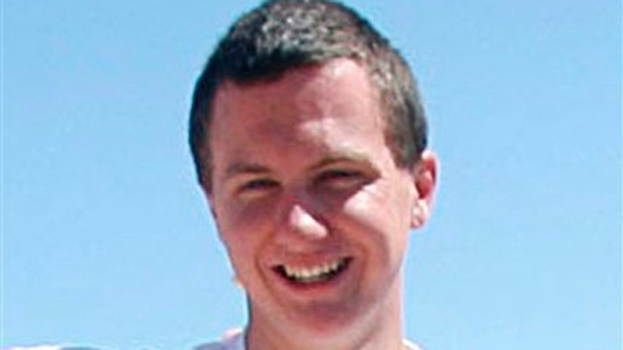 This March 2010 photo shows a man identified as Jared L. Loughner at the 2010 Tucson Festival of Books in Tucson, Ariz.