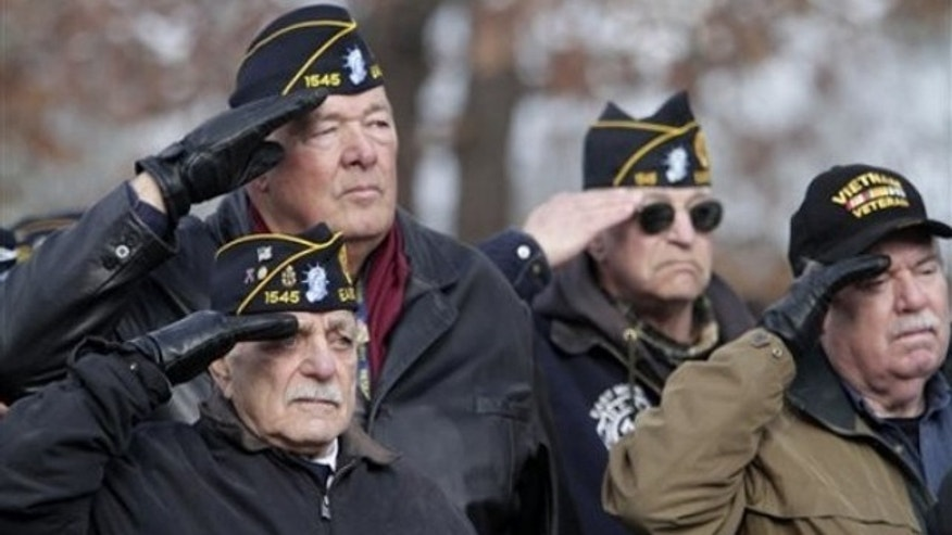 Jan. 8: Veterans stand at attention during the burial ceremony at Calverton National Cemetery (AP).