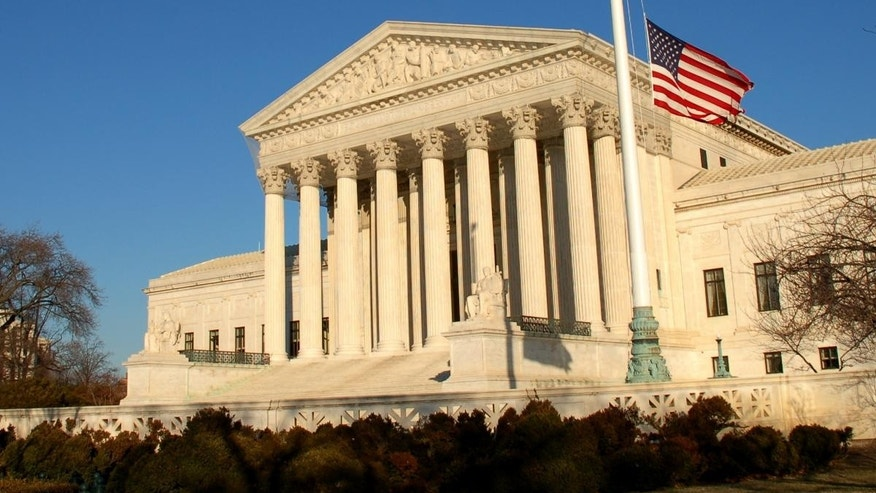 The flag in front of the Supreme Court flies at half-staff after the Tucson shootings.  Fox News Photo