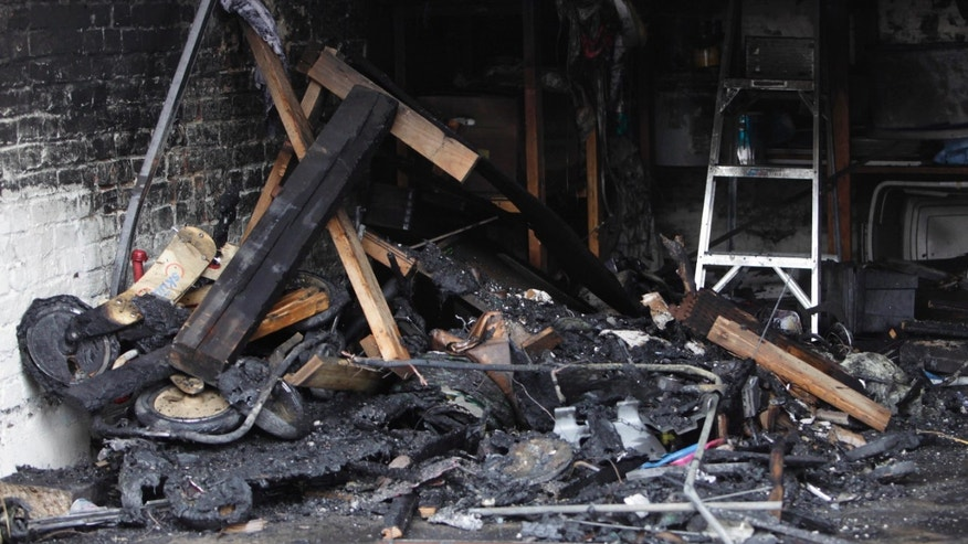 Monday: Burnt debris fills a garage in Southeast Washington, where a Washington lobbyist was found dead. Ashley Turton, the wife of a White House adviser Dan Turton, was found after firefighters extinguished a burning car in the couple's garage.