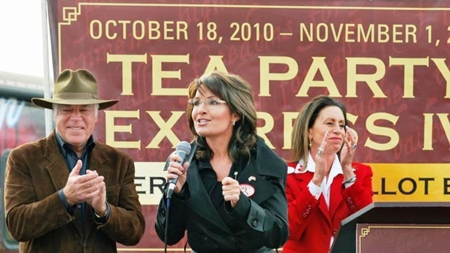 FILE: In this Oct. 30, 2010, photo, Sarah Palin campaigns in Wheeling, W.Va., for ultimately unsuccessful U.S. Senate candidate John Raese, a Republican Tea Party-backed candidate.