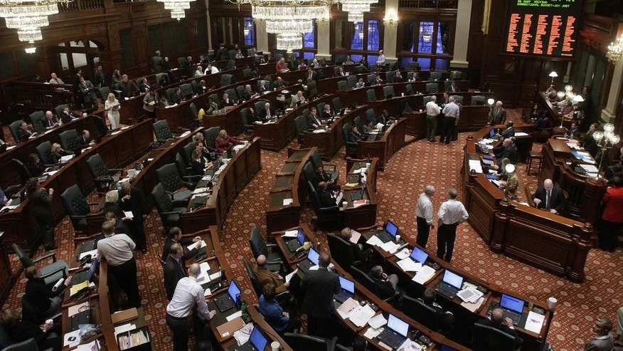 Illinois lawmakers tackle state budget legislation while on the House floor during session at the Illinois State Capitol in Springfield, Ill., Tuesday, Jan. 11, 2011. (AP Photo/Seth Perlman)