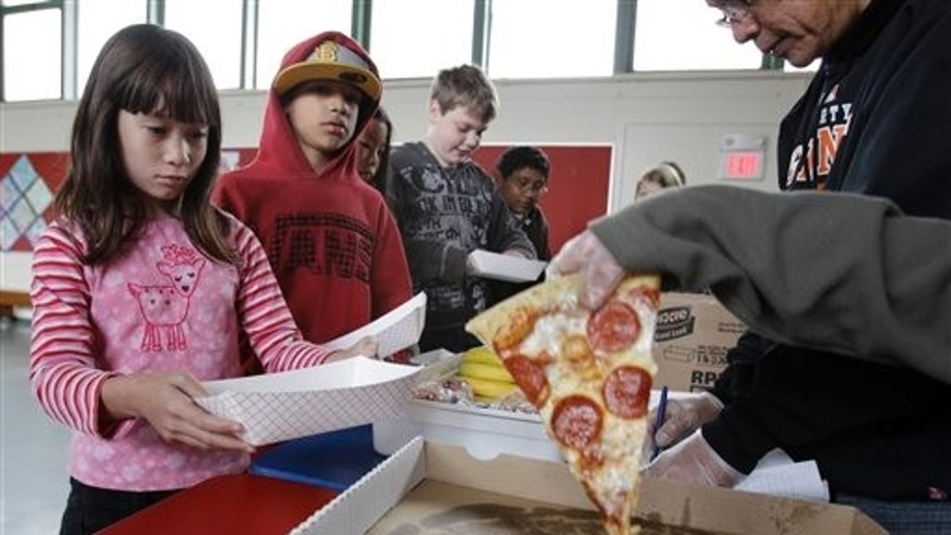Fairmeadow Elementary School students line up for pizza during a school lunch program in Palo Alto, Calif., Dec. 2. (AP Photo)