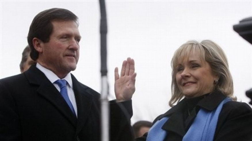 Monday: With her husband Wade Christensen at her side, Oklahoma Governor Mary Fallin takes her oath of office during her inauguration at the state Capitol in Oklahoma City.