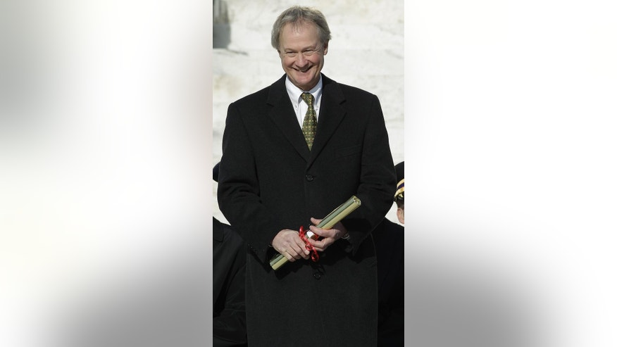 Gov. Lincoln Chafee, a former Republican U.S. senator, holds his certificate of election after taking the oath of office as Rhode Island's first independent governor on the steps of the Statehouse in Providence, R.I., Tuesday afternoon, Jan. 4, 2011. (AP Photo/Stephan Savoia)