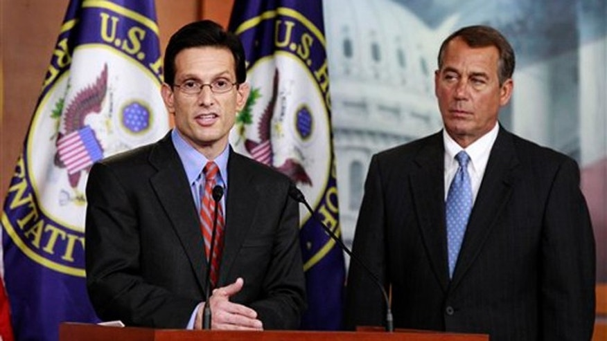 House Speaker John Boehner, right, looks on as House Majority Leader Eric Cantor speaks during a news conference on Capitol Hill Jan. 6.